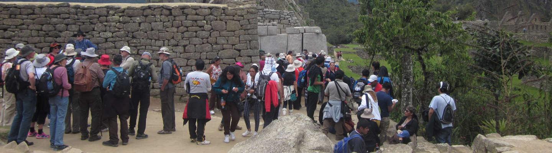 How many tourists visit Machu Picchu annually?